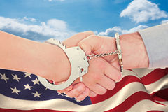 Composite image of handcuffed business people shaking hands Royalty Free Stock Photo