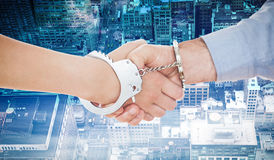 Composite image of handcuffed business people shaking hands Stock Photography