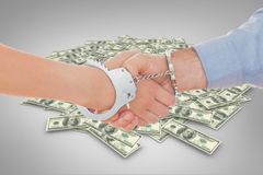 Composite image of handcuffed business people shaking hands royalty free illustration