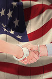 Composite image of handcuffed business people shaking hands Stock Photos