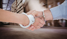 Composite image of handcuffed business people shaking hands Stock Image
