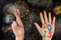 Composite image of hands. Hands against colourful fireworks exploding on black background stock illustration