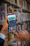 Composite image of hands of businessman using calculator Royalty Free Stock Image