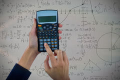 Composite image of hands of businesswoman using calculator Royalty Free Stock Photography