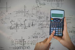 Composite image of hands of businesswoman using calculator Royalty Free Stock Image