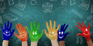 Composite image of hands with colourful smiley faces Stock Images