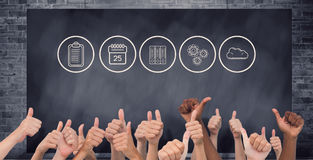 Composite image of hands giving thumbs up Royalty Free Stock Image