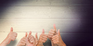 Composite image of hands giving thumbs up Stock Photo
