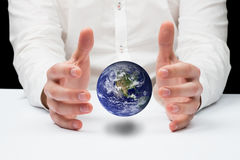 Composite image of hands holding. Hands holding against the earth Royalty Free Stock Images