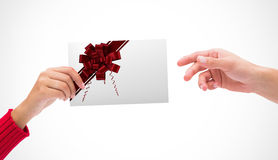 Composite image of hands holding card Stock Photo