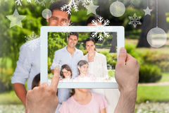 Composite image of hands holding tablet pc Stock Image