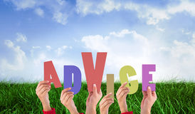 A Composite image of hands holding up advice Royalty Free Stock Photography