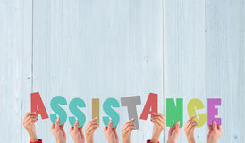 A Composite image of hands holding up assistance Stock Photos