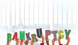Composite image of hands holding up bankruptcy Royalty Free Stock Image