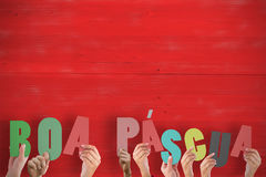 A Composite image of hands holding up boa pasqua Stock Image