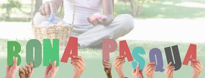 A Composite image of hands holding up bona pasqua Stock Photo