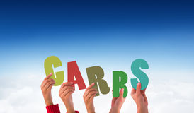 A Composite image of hands holding up carbs Royalty Free Stock Photography