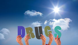A Composite image of hands holding up drugs Royalty Free Stock Image