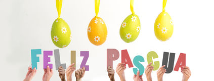 A Composite image of hands holding up feliz pasqua Royalty Free Stock Images
