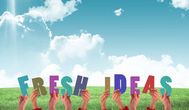 Composite image of hands holding up fresh ideas Royalty Free Stock Photo