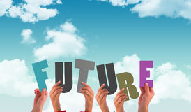 Composite image of hands holding up future. Hands holding up future    against blue sky Stock Image