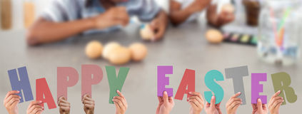 A Composite image of hands holding up happy easter Stock Photography