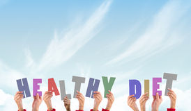 A Composite image of hands holding up healthy diet Stock Photo