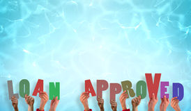 Composite image of hands holding up loan approved Royalty Free Stock Images
