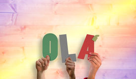 Composite image of hands holding up ola Stock Image