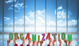 Composite image of hands holding up organization Royalty Free Stock Images