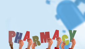 A Composite image of hands holding up pharmacy Stock Photo