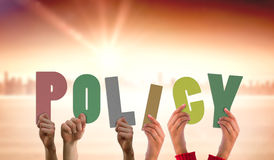 Composite image of hands holding up policy Royalty Free Stock Photo