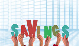 Composite image of hands holding up savings Stock Photos