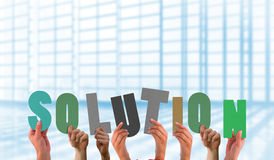 Composite image of hands holding up solution Royalty Free Stock Image