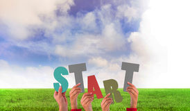 A Composite image of hands holding up start Stock Images