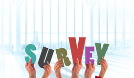Composite image of hands holding up survey Stock Photography