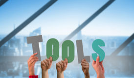 Composite image of hands holding up tools Royalty Free Stock Photography