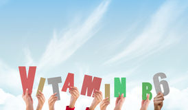 A Composite image of hands holding up vitamin b6 Stock Image