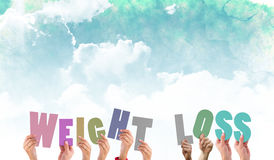 A Composite image of hands holding up weight loss Royalty Free Stock Photos