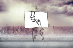 Composite image of hands joining doodle on easel Royalty Free Stock Image