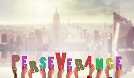 Composite image of hands showing perseverance Royalty Free Stock Photography