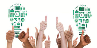 Composite image of hands showing thumbs up. Hands showing thumbs up against business tools in light bulb shape Royalty Free Stock Images