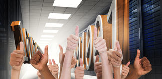 Composite image of hands showing thumbs up. Hands showing thumbs up against 3d binary code in data center hallway Stock Images