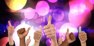 Composite image of hands showing thumbs up Stock Photo