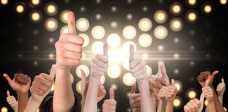Composite image of hands showing thumbs up Royalty Free Stock Images