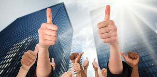 Composite image of hands showing thumbs up Stock Photography