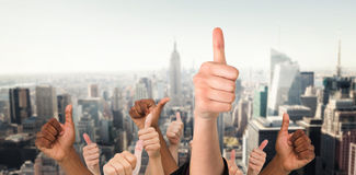 Composite image of hands showing thumbs up Stock Images