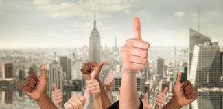 Composite image of hands showing thumbs up Stock Image