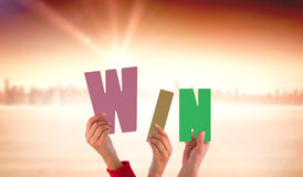 Composite image of hands showing win Royalty Free Stock Image