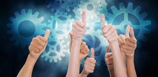 Composite image of hands up and thumbs raised Stock Images